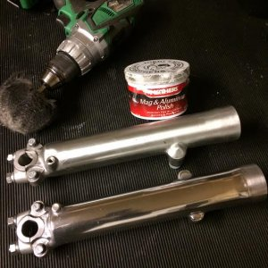 Polishing forks before installing new oil seals. One is nearly finished.